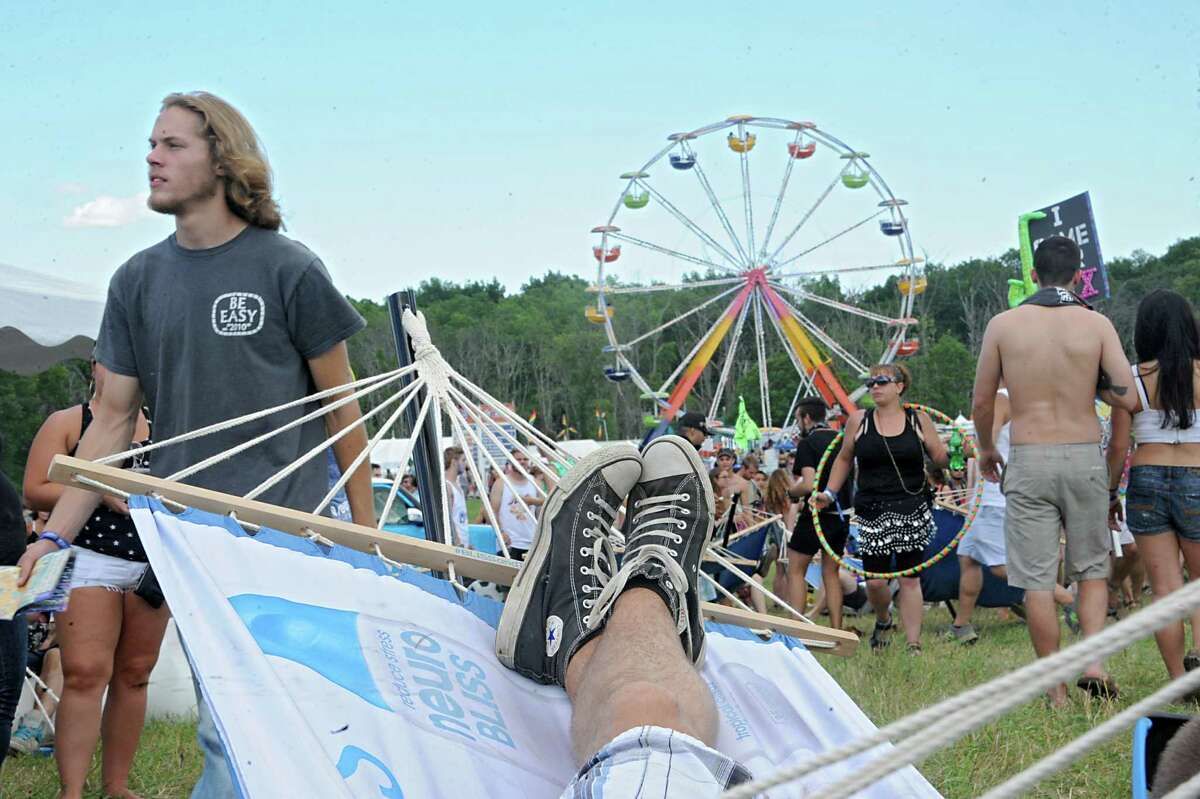 Concert goers soak in the seen at the Hudson Project music and arts festival on Winston Farm Friday, July 11, 2014 in Saugerties, N.Y. (Lori Van Buren / Times Union)