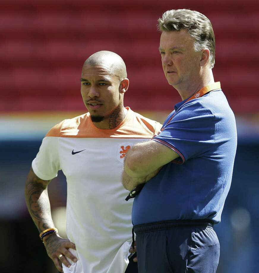 Netherlands coach Louis van Gaal (right) and player Nigel de Jong attend a training session Friday in Brasilia, Brazil. The Oranje could end the World Cup unbeaten in regular play. Photo: Andre Penner / Associated Press / AP