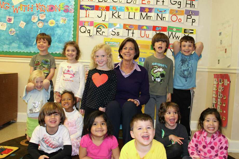 Family Centersí Board Chairman Laurie Host meets with children from Family Centersí Arch Street preschool. Photo: Contributed Photo / Greenwich Time Contributed