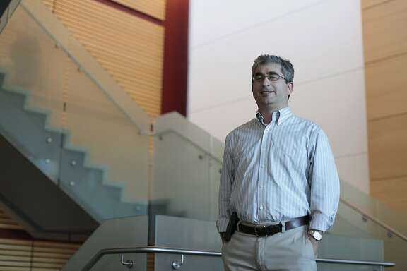 Dr. Brian Feldman poses for a portrait at Stanford University in Palo Alto, Calif. on Wednesday, July 9, 2014. This microchip helps to distinguish between the two main forms of diabetes.