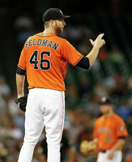 Astros starting pitcher Scott Feldman (46) took the loss after allowing seven runs in 51⁄3 innings against the Red Sox on Friday night. Photo: Karen Warren, Staff / © 2014 Houston Chronicle