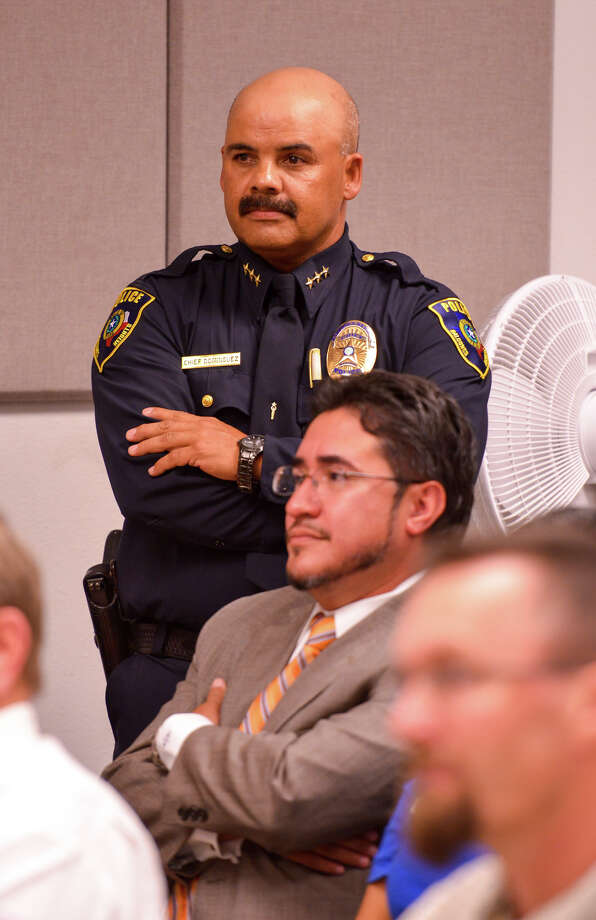 Balcones Heights Police Chief Henry Dominguez and his attorney Mark Anthony Sanchez during a city council meeting to discuss Dominguez job status. Photo: For The San Antonio Express-News