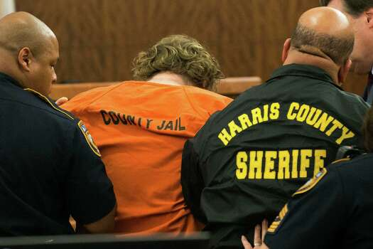 Accused mass shooter Ron Lee Haskell collapses as he appears in court on Friday, July 11, 2014, in Houston. Haskell is accused of a mass shooting that resulted in the death of six people. ( Brett Coomer / Houston Chronicle ) Photo: Brett Coomer, Staff / © 2014 Houston Chronicle