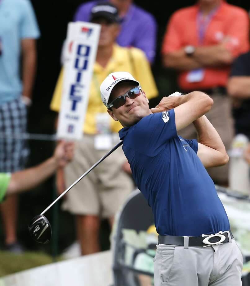 Zach Johnson tees off on  the 18th hole, where he completed a round of 67. Photo: Charles Rex Arbogast, Associated Press