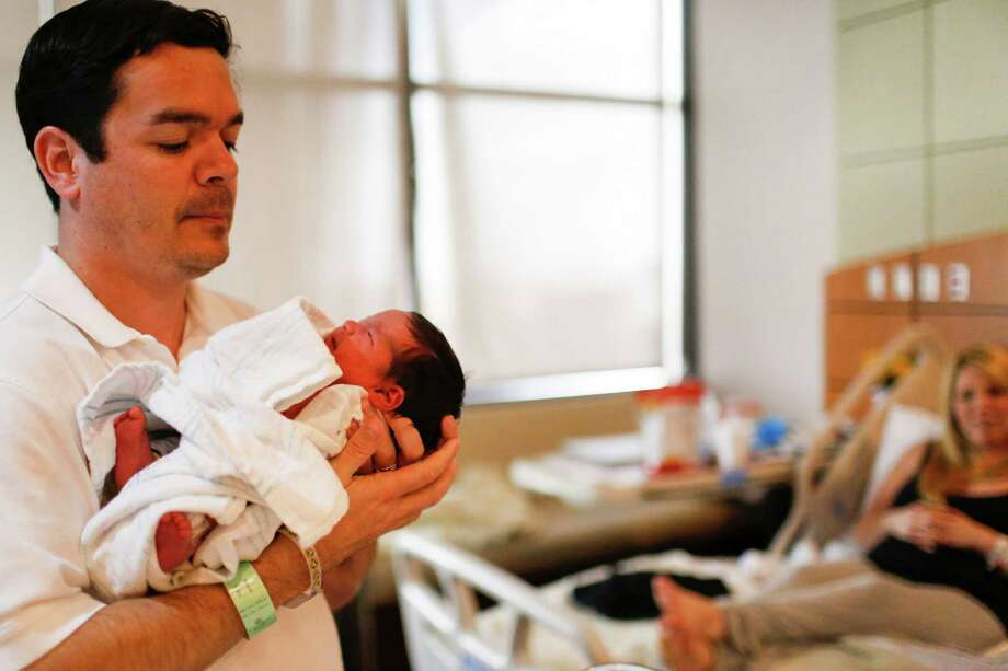 Andy Mejia holds his newborn daughter, Dottie, at the Texas Children's Pavilion for Women. Photo: Eric Kayne / Eric Kayne