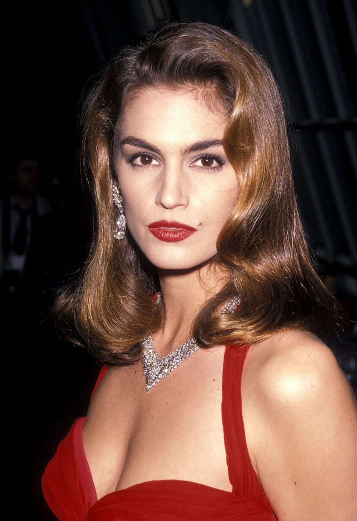 Cindy Crawford in 1990 at 24. Crawford, known for her trademark mole, was one of the biggest supermodels in the late '80s and early '90s.