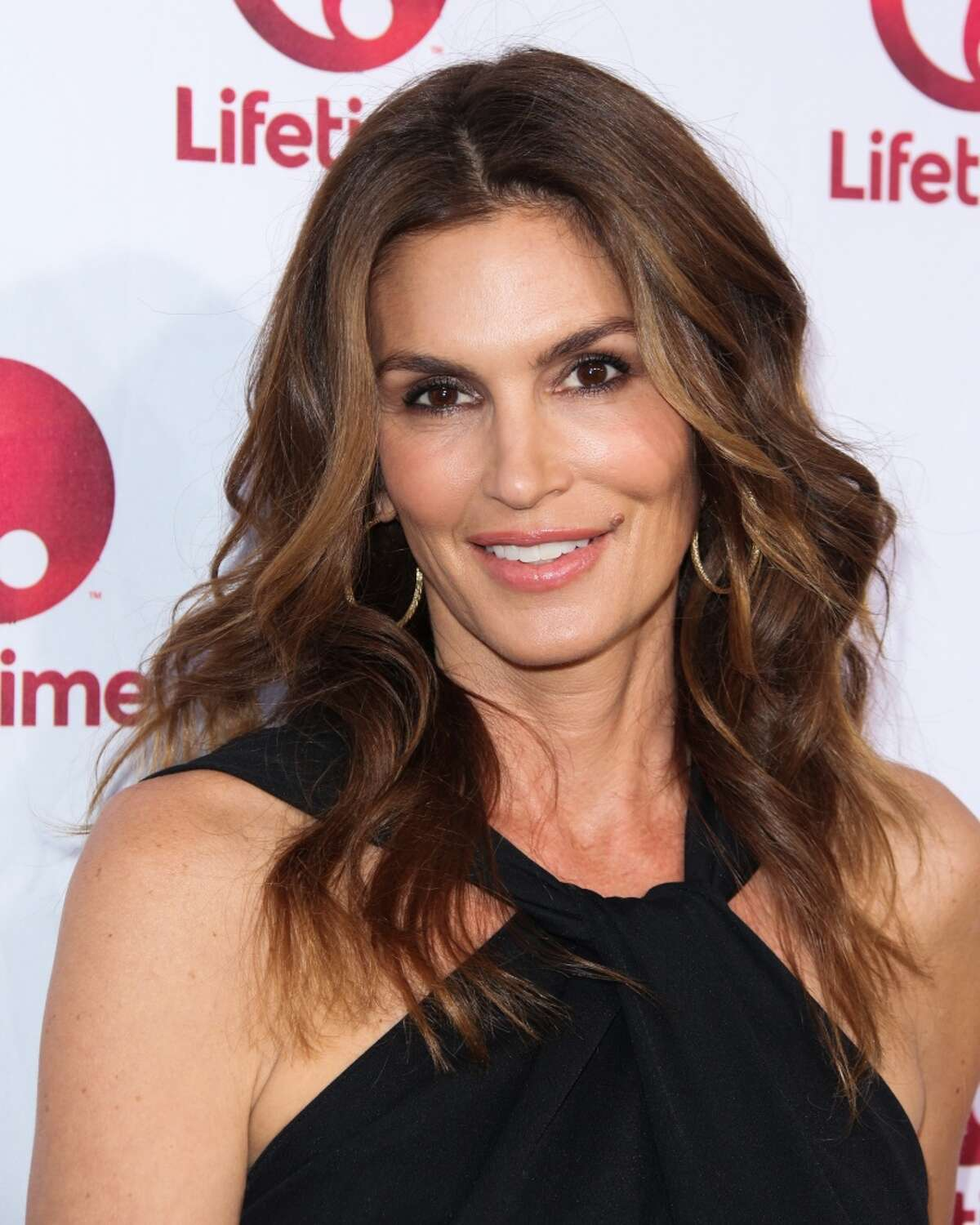 Cindy Crawford in 2014. Crawford has a line of beauty products, Meaningful Beauty, as well a furniture collection.