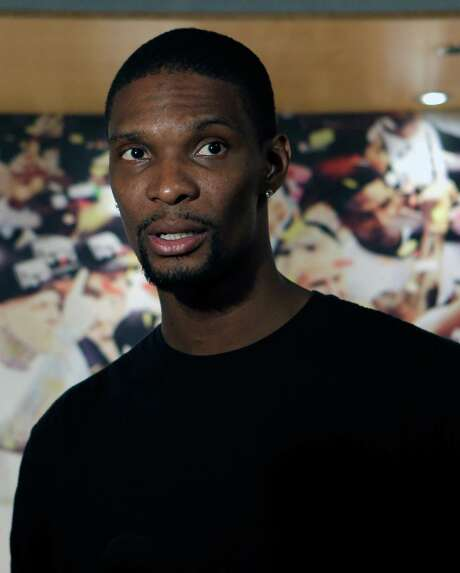 Miami Heat's Chris Bosh talks to a reporter after a news conference in Miami, Tuesday, June 17, 2014. The Miami Heat held their season-wrapup team meeting on Tuesday afternoon and one of the biggest questions is about the future of the roster. (AP Photo/Alan Diaz) Photo: Alan Diaz, STF / AP