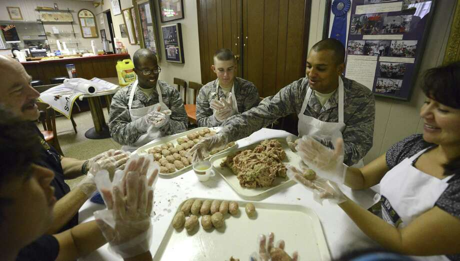 Servicemen Carmichael Green (from left), Caleb Beverly and Richard Dickson help roll meatballs for the 100 Club of San Antonio's annual spaghetti dinner, set this weekend at the Christopher Columbus Italian Society Banquet Hall. Photo: Billy Calzada / San Antonio Express-News / San Antonio Express-News