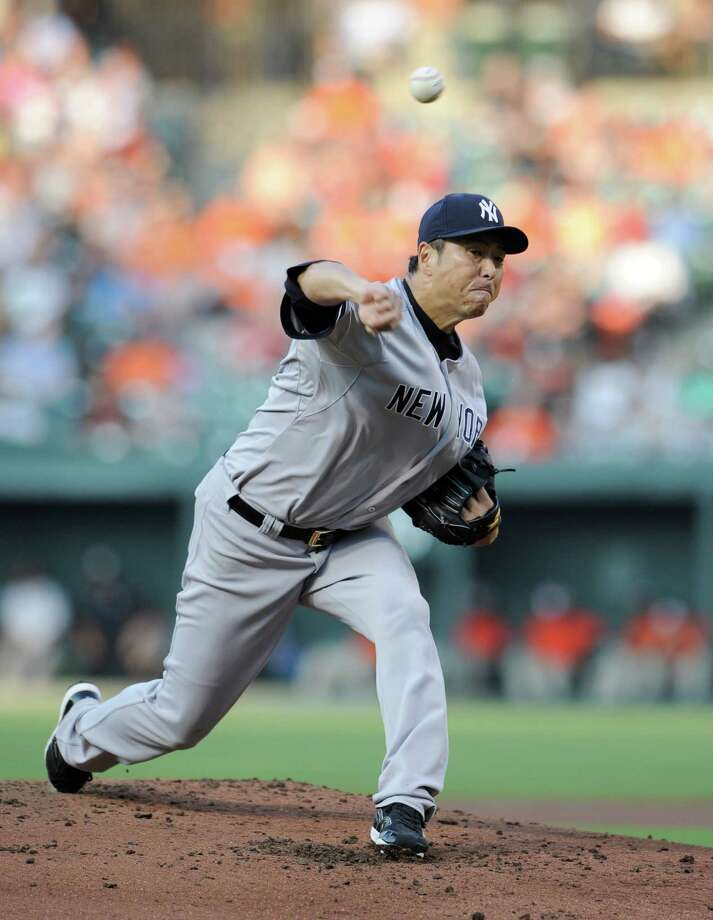 New York Yankees starting pitcher Hiroki Kuroda, of Japan, delivers a pitch against the Baltimore Orioles during the first inning of a baseball game, Friday, July 11, 2014, in Baltimore. (AP Photo/Nick Wass) ORG XMIT: BAB103 Photo: Nick Wass / FR67404 AP