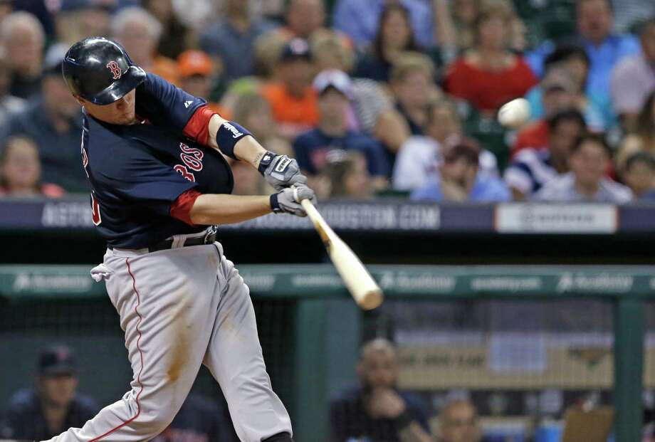 Boston Red Sox's Christian Vazquez hits an RBI ground-rule double against the Houston Astros in the fourth inning of a baseball game Friday, July 11, 2014, in Houston. (AP Photo/Pat Sullivan) ORG XMIT: HTA106 Photo: Pat Sullivan / AP