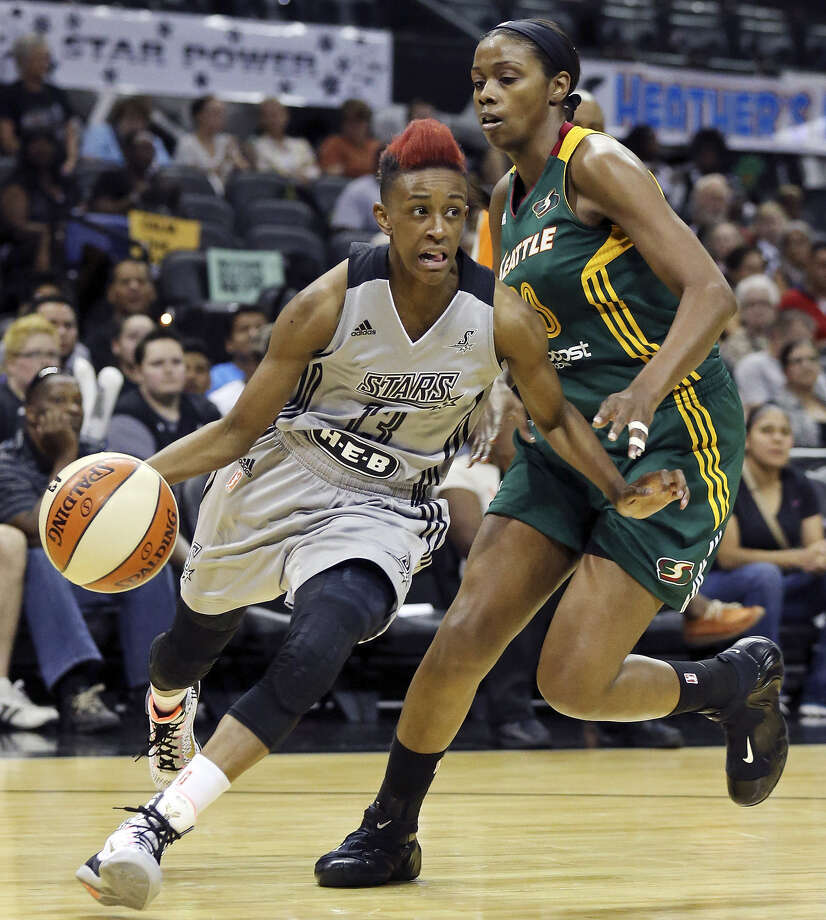 The Stars' Danielle Robinson (left) tries to maneuver around the Storm's Camille Little. Robinson finished with 10 points. Photo: Edward A. Ornelas / San Antonio Express-News / © 2014 San Antonio Express-News