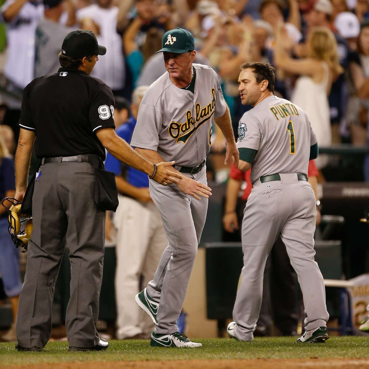SEATTLE, WA - JULY 11: Manager Bob Melvin #6 of the Oakland Athletics argues with home plate umpire James Hoye #92 after Nick Punto #1 was called out on strikes to end the game in a 3-2 loss to the Seattle Mariners at Safeco Field on July 11, 2014 in Seattle, Washington. (Photo by Otto Greule Jr/Getty Images)
