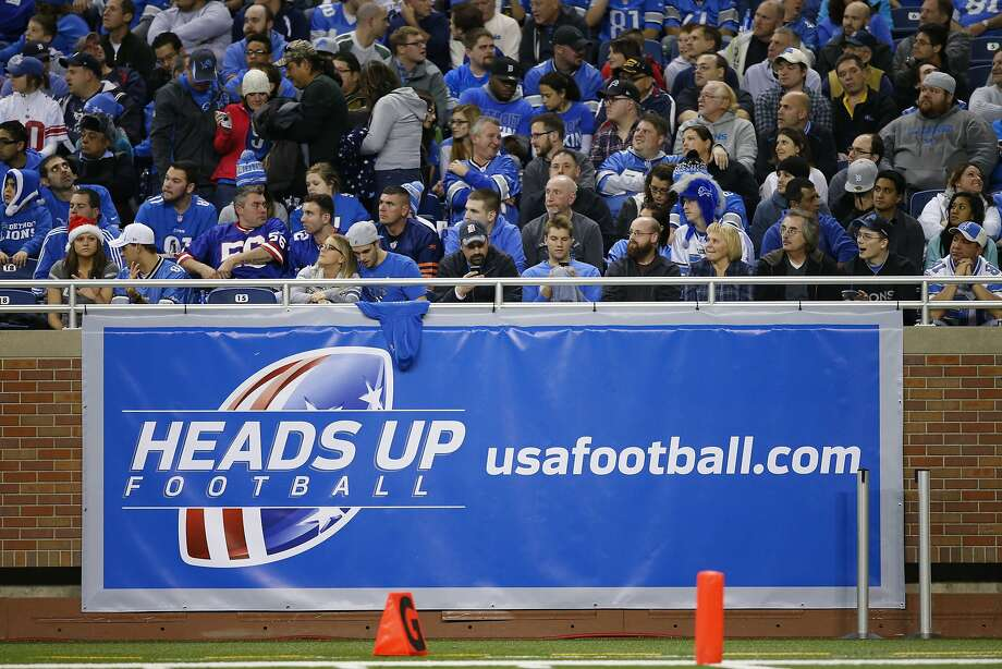 A banner at a Detroit Lions football game promotes a campaign meant to make the sport safer for young players. Photo: Rick Osentoski, Associated Press