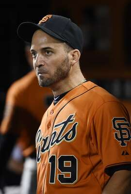 SAN FRANCISCO, CA - JULY 11:  Marco Scutaro #19 of the San Francisco Giants looks on from the dugout against the Arizona Diamondbacks in the bottom of the eighth inning at AT&T Park on July 11, 2014 in San Francisco, California.  (Photo by Thearon W. Henderson/Getty Images)