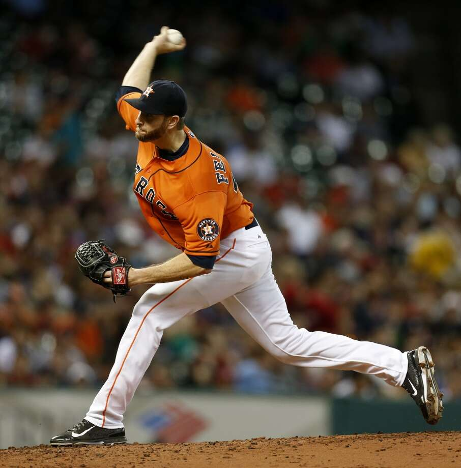 July 11: Red Sox 8, Astros 3  Scott Feldman pitches in the second inning. Photo: Karen Warren, Houston Chronicle