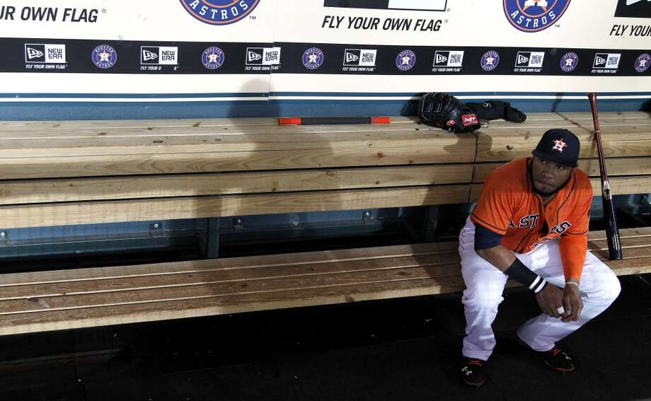 Jon Singleton sits in the dugout before the Friday's game against the Red Sox. Photo: Karen Warren, Houston Chronicle