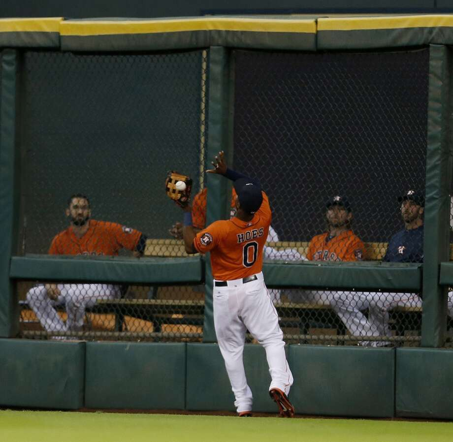 L.J. Hoes (0) chases a triple in the third inning. Photo: Karen Warren, Houston Chronicle