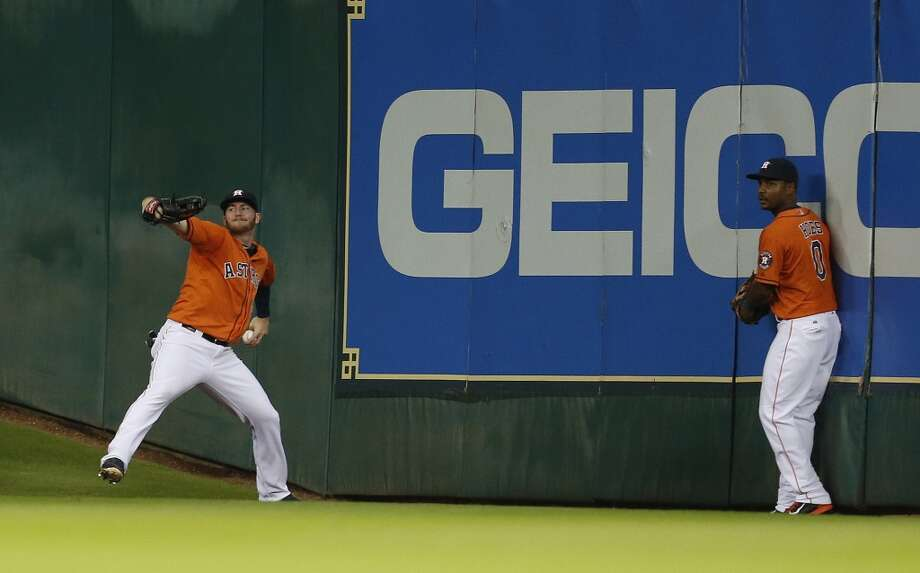 Robbie Grossman, left,chases a triple in the fourth inning. Photo: Karen Warren, Houston Chronicle