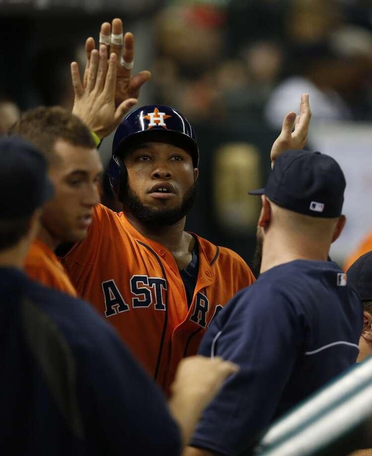 Jon Singleton celebrates his run scored with Astros teammates. Photo: Karen Warren, Houston Chronicle