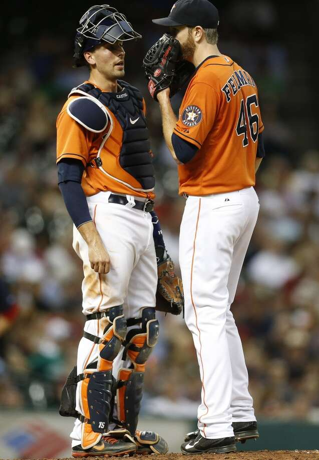 Jason Castro, left, chats with starting pitcher Scott Feldman in the sixth inning. Photo: Karen Warren, Houston Chronicle