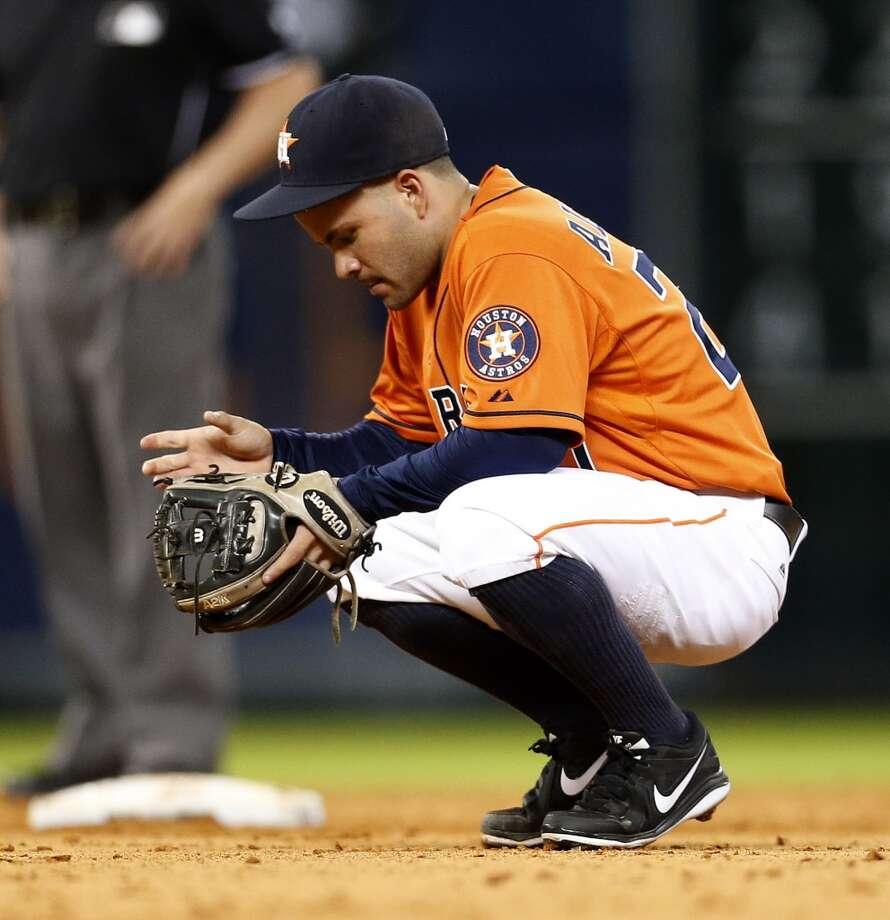 Astros second baseman Jose Altuve takes a break in the sixth inning. Photo: Karen Warren, Houston Chronicle