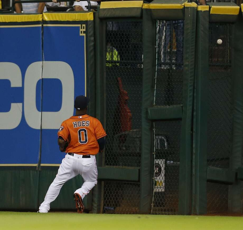 Astros left fielder L.J. Hoes (0) chases a double in the sixth inning. Photo: Karen Warren, Houston Chronicle