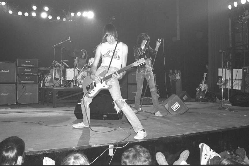 NEW YORK - JANUARY 07: The Ramones perform live on stage at The Palladium, New York on January 07 1978 L-R Tommy Ramone (drums) Johnny Ramone (guitar) Joey Ramone (vocals) (Photo by Richard E. Aaron/Redferns)