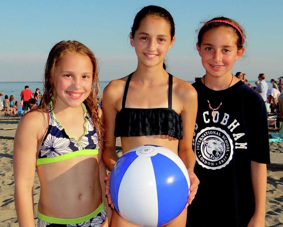 Fairfielders Alexa Amster, 11; Katie Antista, 11, and Maddy Goodman, 10, enjoy Friday's Sand Jam Movie Night. Photo: Mike Lauterborn / Fairfield Citizen