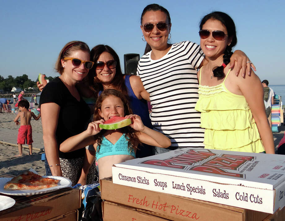 Stratfield neighbors Amy Vanderbes, Shari Gilman, Ryan Gilman, Lisa Bertot and Diana Klein enjoy pizza at Jennings Beach on Friday evening. Photo: Mike Lauterborn / Fairfield Citizen