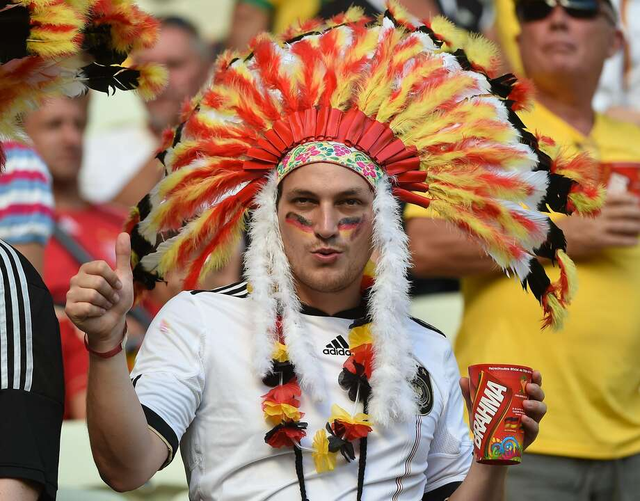 Germany's fans wearing Indian headdress cheers before the Group G football match between Germany and Ghana at the Castelao Stadium in Fortaleza during the 2014 FIFA World Cup on June 21, 2014. AFP PHOTO / PATRIK STOLLARZPATRIK STOLLARZ/AFP/Getty Images Photo: Patrik Stollarz, AFP/Getty Images
