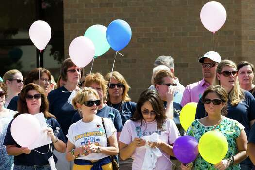 People hold balloons as the gather for a community memorial celebrating the lives of the Stay family at Lemm Elementary School Saturday, July 12, 2014, in Spring. Photo: Brett Coomer, Houston Chronicle / © 2014 Houston Chronicle