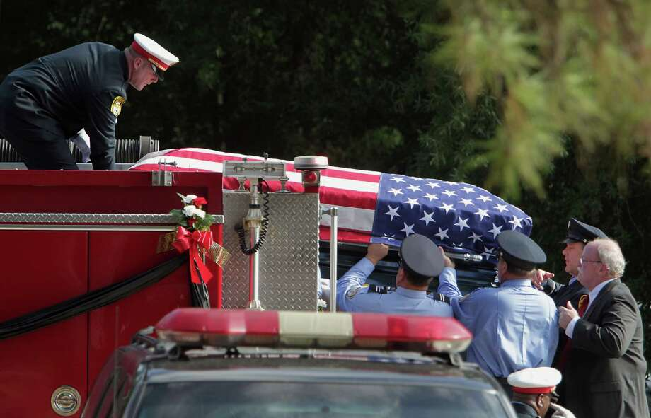 Firefighters remove the casket of Houston Fire Department Firefighter Daniel Groover who died while battle a blaze on the 9th of July, during the procession and memorial service at The Woodlands Church Saturday, July 12, 2014, in The Woodlands. Photo: James Nielsen, Houston Chronicle / © 2014  Houston Chronicle