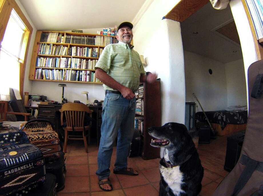 "Gary Oliver, who said that he ""rode into Marfa on a bike and never left,"" is working against the higher tax bills that many residents are receiving. Photo: Billy Calzada, San Antonio Express-News / San Antonio Express-News"
