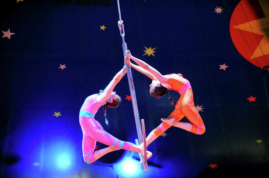 Aerialists Maedya Kojis, 14, left, and Lola Picayo, 13, swing from an anchor during the Circus Smirkus performance of Anchors Away for Atlantis on Saturday, July 12, 2014, at the Saratoga Casino and Raceway in Saratoga Springs, N.Y. The second show is Sunday at 1 p.m. (Cindy Schultz / Times Union) Photo: Cindy Schultz / 00027730A