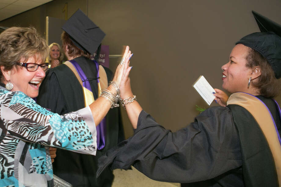 A scene from the Excelsoir College commencement on July 11. (Michael Hemberger / photographer) Photo: Mike Hemberger