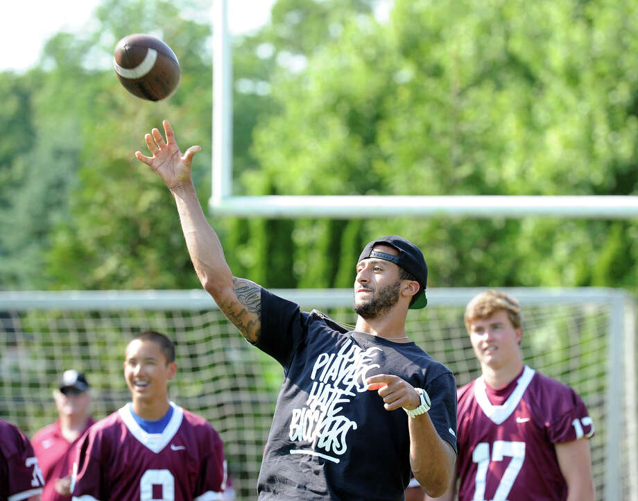 San Francisco 49ers quarterback Colin Kaepernick throws passes to St. Luke's football players during his visit to the St. Luke's School in New Canaan, Conn., Saturday afternoon, July 12, 2014. Kaepernick visited the school on behalf of the Children of Fallen Patriots Foundation that provides college scholarships and educational counseling to military children who have lost a parent in the line of duty. The foundation was founded by husband and wife, David and Cynthia Kim of Greenwich. Photo: Bob Luckey / Greenwich Time