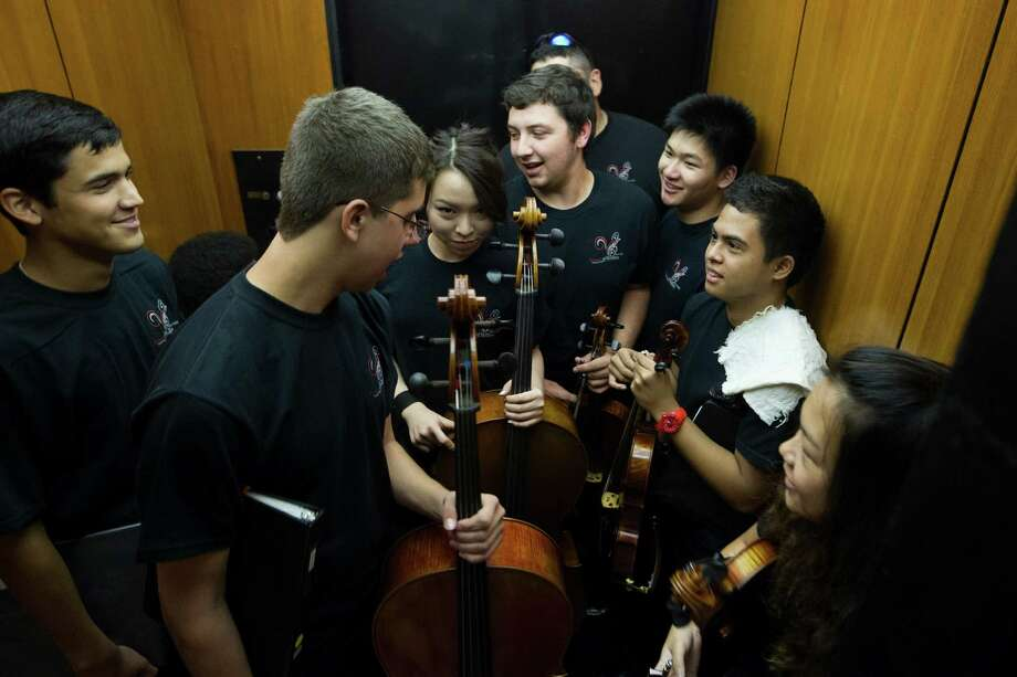 Members of Virtuosi of Houston crowd into an elevator on their way to their performance during the 2nd Annual Houston Symphony Free Day of Music at Jones Hall Saturday, July 12, 2014, in Houston. Photo: Brett Coomer, Houston Chronicle / © 2014 Houston Chronicle