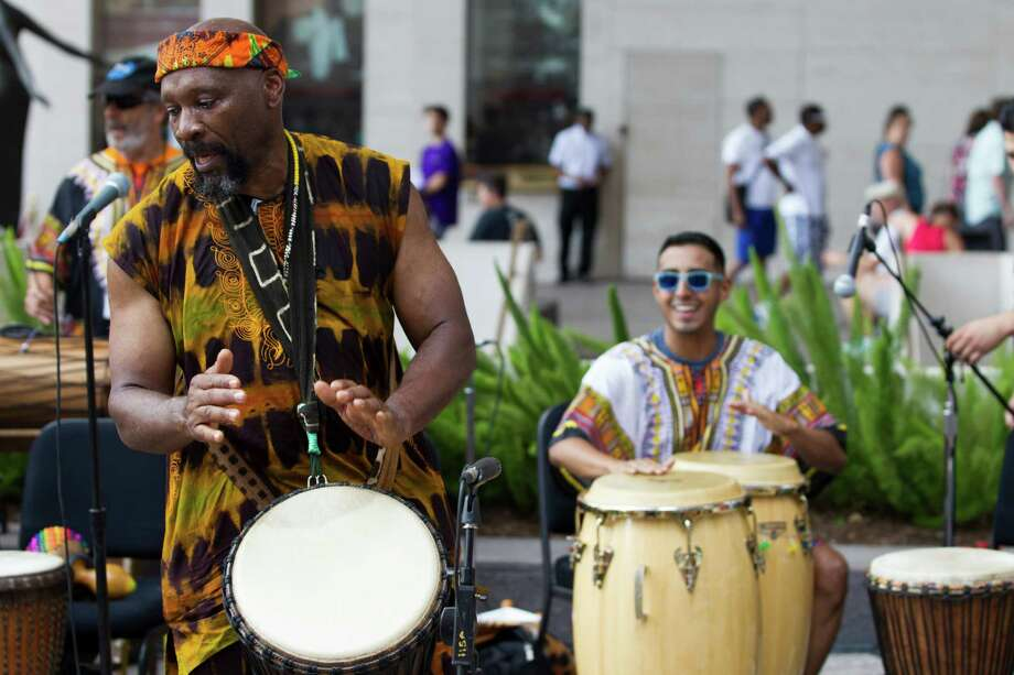Gregory Powell, of The Joy of Djembe Drumming, performs on the Outside Patio Stage during the 2nd Annual Houston Symphony Free Day of Music at Jones Hall Saturday, July 12, 2014, in Houston. Photo: Brett Coomer, Houston Chronicle / © 2014 Houston Chronicle