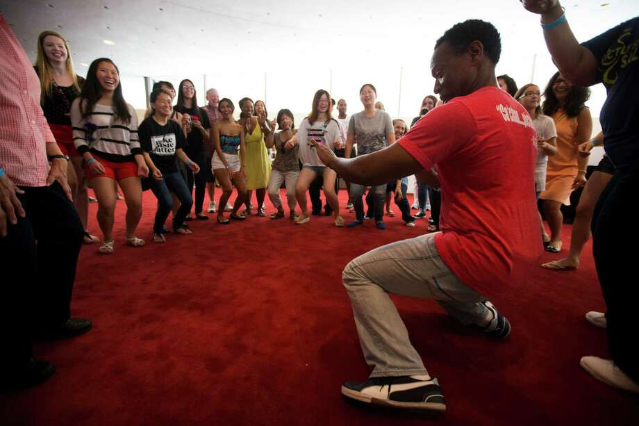 Raul Orlando Edwards, right, of Strictly Street Salsa, leads a dance class during the 2nd Annual Houston Symphony Free Day of Music at Jones Hall Saturday, July 12, 2014, in Houston. Photo: Brett Coomer, Houston Chronicle / © 2014 Houston Chronicle
