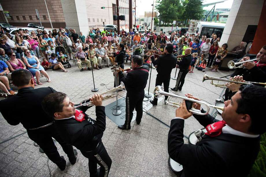 Mariachi 2000 performs on the Outside Patio Stage during the 2nd Annual Houston Symphony Free Day of Music at Jones Hall Saturday, July 12, 2014, in Houston. Photo: Brett Coomer, Houston Chronicle / © 2014 Houston Chronicle