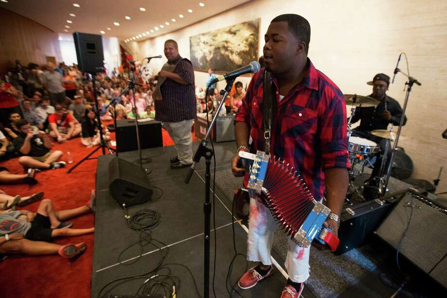 Keyun and the Zydeco Masters perform on the Rear Lobby Stage during the 2nd Annual Houston Symphony Free Day of Music at Jones Hall Saturday, July 12, 2014, in Houston. Photo: Brett Coomer, Houston Chronicle / © 2014 Houston Chronicle