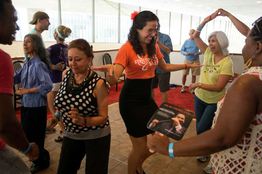Mercedes Malaga, left, and Cucha Lopez, center right, of Strictly Street Salsa, dance during the 2nd Annual Houston Symphony Free Day of Music at Jones Hall Saturday, July 12, 2014, in Houston. Photo: Brett Coomer, Houston Chronicle / © 2014 Houston Chronicle