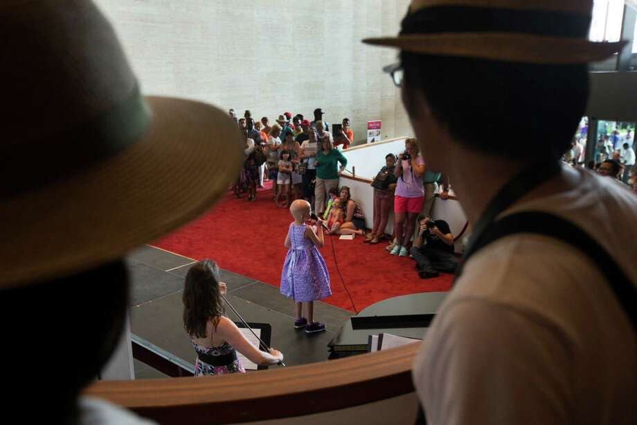 Mia Spargo, 7, sings on the Texas Avenue Stage during the 2nd Annual Houston Symphony Free Day of Music at Jones Hall Saturday, July 12, 2014, in Houston. Photo: Brett Coomer, Houston Chronicle / © 2014 Houston Chronicle
