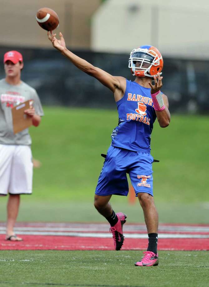 Danbury quarterback Anferny Ith passes the ball during the 7th annual Grip It and Rip It 7-on-7 passing tournament at New Canaan High School Saturday, July 12, 2014. Photo: Autumn Driscoll / Connecticut Post