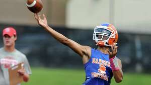Danbury quarterback Anferny Ith passes the ball during the 7th annual Grip It and Rip It 7-on-7 passing tournament at New Canaan High School Saturday, July 12, 2014.