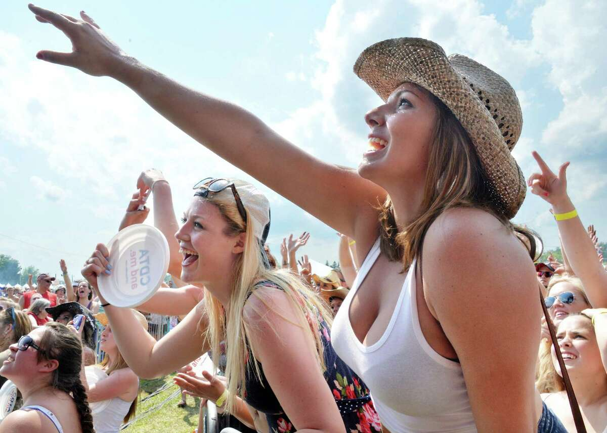 Fans Abigael Roy and Abby Ionati, right, call up to the stage as Scotty McCreery performs at the annual Countryfest show at the Schaghticoke Fairgrounds Saturday July 12, 2014, in Schagticoke, NY. (John Carl D'Annibale / Times Union)