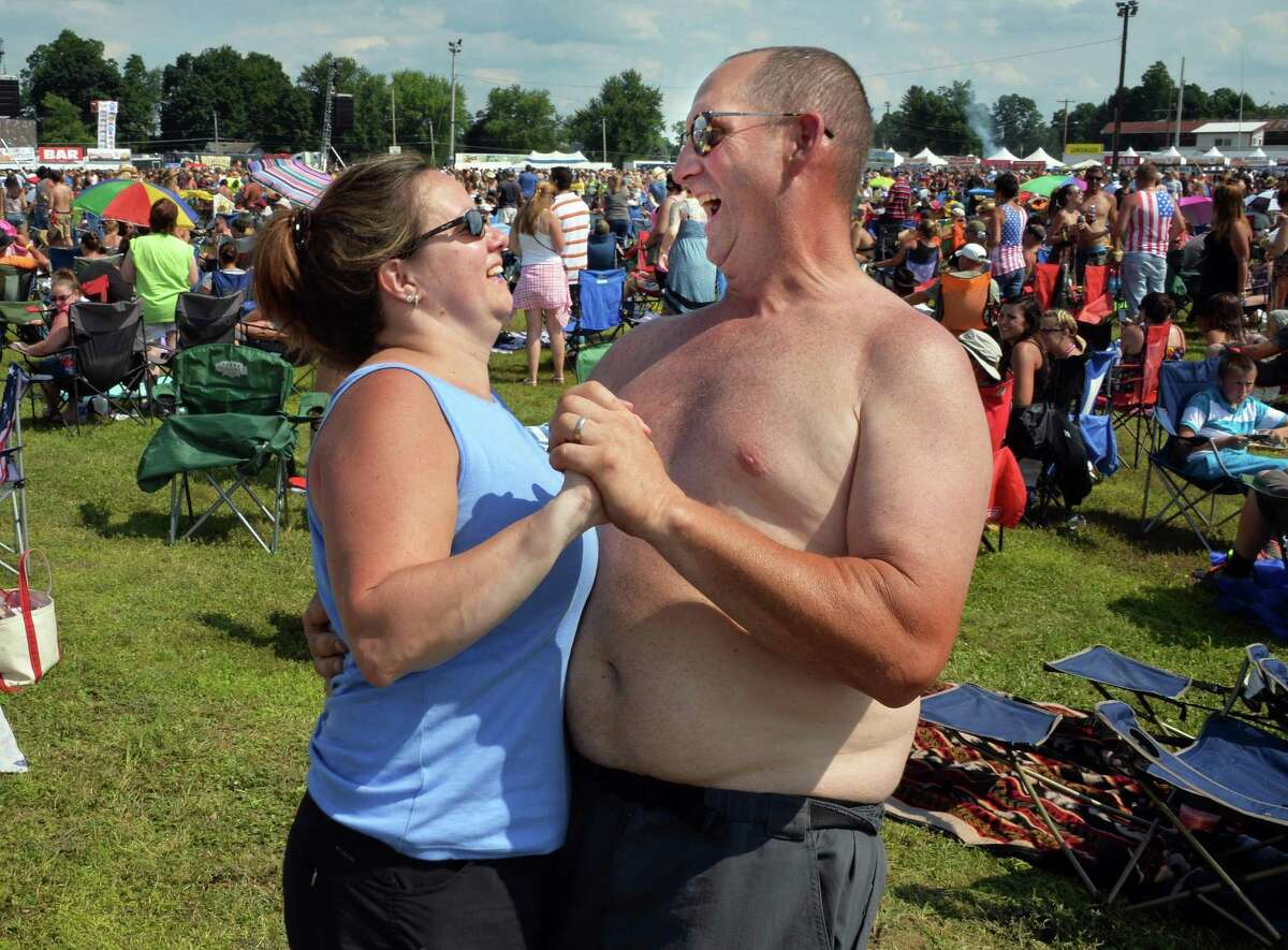 Susan and Scott Luhrmann of Canaan dance during the Schaghticoke Fairgrounds Saturday July 12, 2014, in Schagticoke, NY. (John Carl D'Annibale / Times Union)