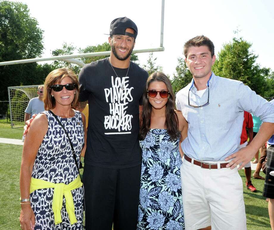 San Francisco 49ers quarterback Colin Kaepernick, second from left, with Sarah Greene of Brandford, Conn., at left, and Sarah's children, Jena, 20, and Wesley,18, right, during his visit to the St. Luke's School in New Canaan, Conn., Saturday afternoon, July 12, 2014. Sarah Greene lost her husband U.S. Marine Lt. Col. David Greene who was killed serving his country in the Iraq War in 2004. Kaepernick visited the school on behalf of the Children of Fallen Patriots Foundation, that helped the Greene family and other families providing college scholarships and educational counseling to military children who have lost a parent in the line of duty. The foundation was founded by husband and wife, David and Cynthia Kim of Greenwich. Photo: Bob Luckey / Greenwich Time