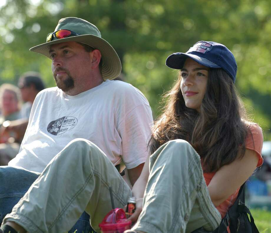 "Brian Wood, 36, and Bernadette Wood, 39, of Southbury, listen to a band during the Roxbury Volunteer Fire Department annual  ""Pickin 'n' Fiddlin"" contest, on Saturday, July 12, 2014, held in Hurlburt Park, in Roxbury, Conn. Photo: H John Voorhees III / The News-Times Freelance"